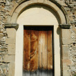 Old romanesque wooden church door, Romania — Stock Photo