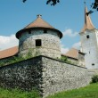 Foto Stock: Fortified church with defense wall in Transylvania, Romania
