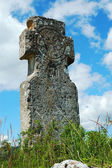 Religious stone cross with beautiful blue sky — ストック写真