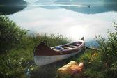 Canoa al lago in luci del mattino — Foto Stock