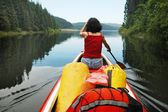 Canoeing girl on a lake — Stock Photo