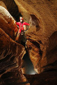 Cave passage with caver — Stock Photo