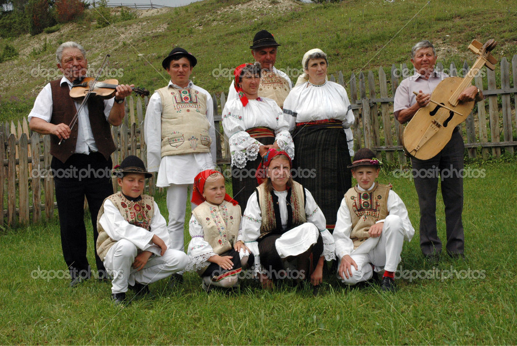 GHIMES, ROMANIA - A group of dancers in traditional clothes participate at a wedding in Ghimes, Transylvania. Traditions in this area are well kept.   Stock Photo #8343187