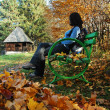 Woman on bench in park at Autumn — Stock Photo #8411733