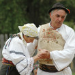 Stock Photo: A group of dancers in traditional clothes in Romania
