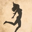 Woman shot in retro-vintage style, silhouette of jumping nude woman — Stock Photo