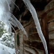 Icicles on a roof — Stok fotoğraf