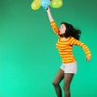 Jumping happy girl with balloons — Stock Photo