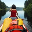 Canoeing girl on a lake — Stock Photo #8413590