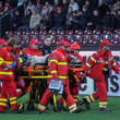 Paramedics in action at a soccer game — Stock Photo
