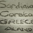 Stock Photo: Different destinations, letters on sand