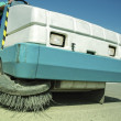 A sweeping machine cleans the parking space — Stock Photo