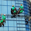 Workers washing the windows facade - Stock Photo