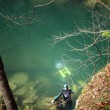 A cave diver emerges from a spring — Stock Photo #9064587