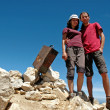 Hiker couple on the summit, Bobotov peak, Montenegro — Stock Photo