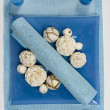 BLUE STILL LIFE WITH COTTON FLOWERS CANDLES and white cotton balls — Stock Photo