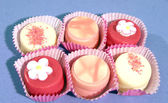 Six delicious cup cakes in pink — Stock Photo