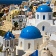 Stock Photo: Churches and houses of Oia