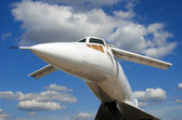 Russian airplane TU-144 general view on blue sky and clouds back — Stock Photo