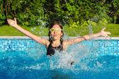 Happy active child having fun in swimming pool — Stock Photo