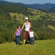 Active mother and children on their vacation in mountains — Foto de Stock