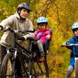 ������, ������: Happy active family cycling on bikes outdoors