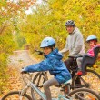 Happy active family cycling on bikes outdoors — Stock Photo #8480047