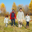 Happy active family in autumn park — Stock Photo #8480061