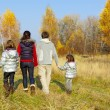 Happy active family in autumn park — Stock Photo #8480071