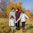 Stock Photo: Happy active family in autumn park