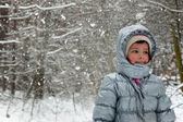 Child and winter snow — Stock Photo