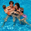 Happy active family with kids in swimming pool — Stock Photo #8974222