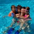 Happy active family with kids in swimming pool — Stock Photo