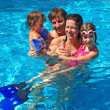Happy active family with kids in swimming pool — Stock Photo #8974235