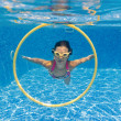 Happy smiling underwater child in swimming pool — Stock Photo