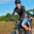 Active family cycling outdoors — Stock Photo #9194374