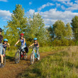 Active family cycling outdoors — ストック写真