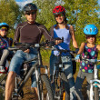 Active family cycling outdoors — Stock Photo #9194474
