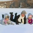 Happy active family having fun on winter snow outdoors — Stock Photo