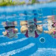 Underwater smiling family having fun and playing in swimming pool — 图库照片