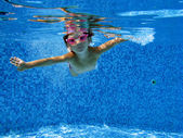 Underwater kid having fun and playing in swimming pool — Stock Photo