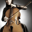 Cello playing cellist musician. — Stock Photo