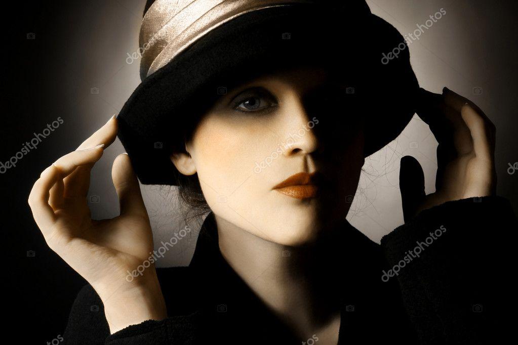 http://static8.depositphotos.com/1356916/1005/i/950/depositphotos_10058023-Retro-portrait-of-woman-in-hat.jpg