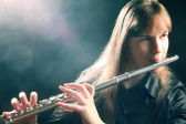 Flute playing flutist musician performer — Stock Photo