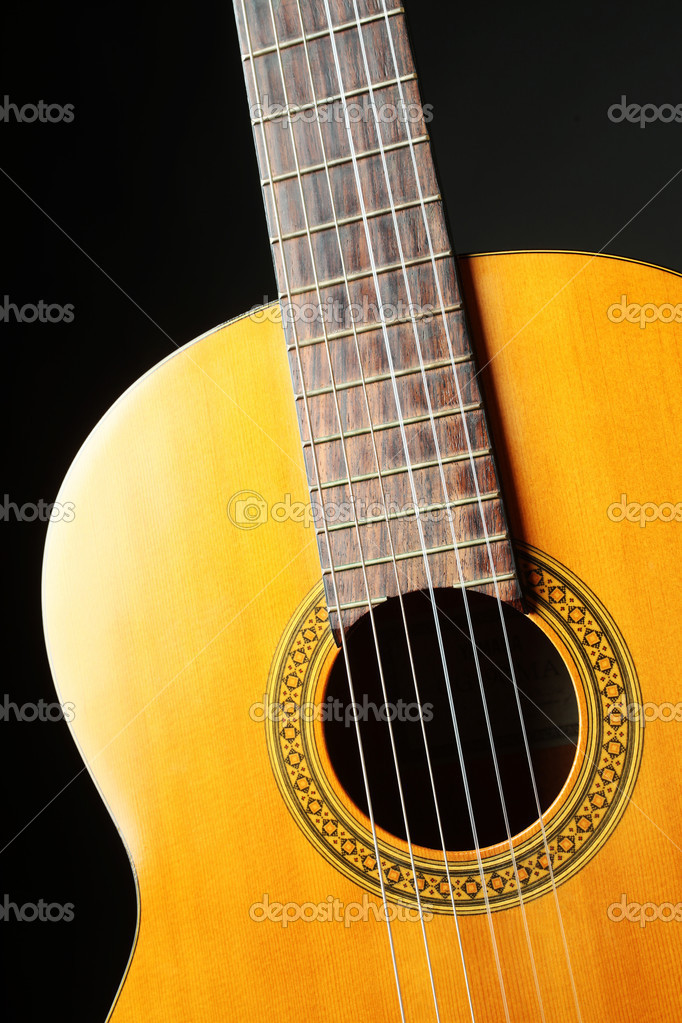 Guitar music art. Acoustic musical instrument on black — Stock Photo #8340398