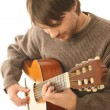 Stock Photo: Acoustic guitar playing guitarist.