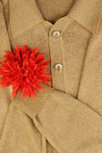 Gold jacket with flower on the heart — Stock Photo