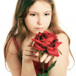 Beautiful child girl with red rose. — Stock Photo
