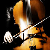 Cello musical instrument with cellist hand — Stock Photo
