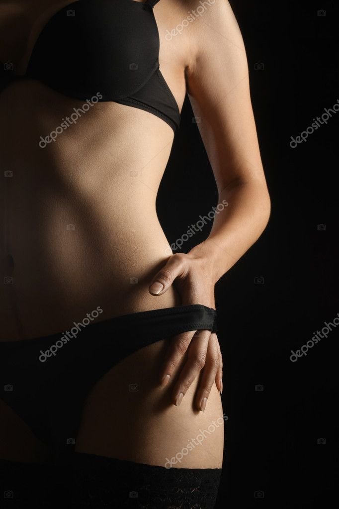 Sexy woman body in black lingerie isolated on black background. — Stock Photo #8865418